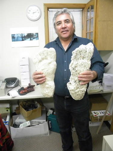 Northern Minnesota Bigfoot Research Team member Don Sherman holds a pair of plaster casts of what they believe are Bigfoot prints